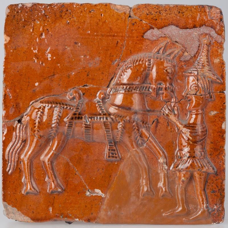 Kafel z postacią giermka trzymającego konia