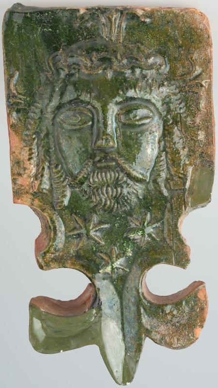 Kafel z wyobrażeniem głowy Chrystusa w koronie cierniowej i częścią w formie lilii