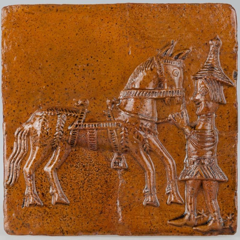 Kafel z giermkiem trzymającym konia