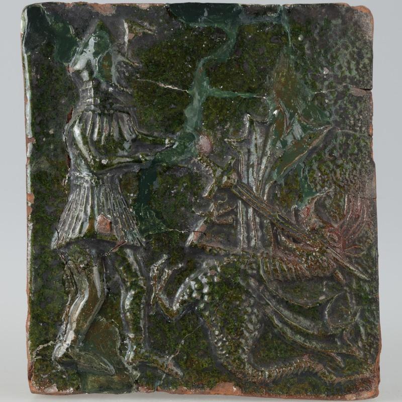 Kafel ze sceną walki rycerza ze smokiem